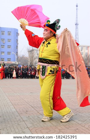 LUANNAN COUNTY - FEBRUARY 15: People wearing colorful clothes, performing yangko dance in the street, during the Chinese Lunar New Year, February 15, 2014, Luannan County, Hebei Province, China.