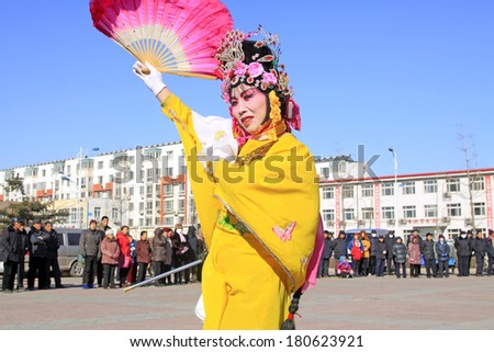 LUANNAN COUNTY - FEBRUARY 9: People wearing colorful clothes, performing yangko dance in the street, during the Chinese Lunar New Year, February 9, 2014, Luannan County, Hebei Province, China.