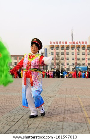 LUANNAN COUNTY - FEBRUARY 7: People wearing colorful clothes, performing yangko dance in the street, during the Chinese Lunar New Year, February 7, 2014, Luannan County, Hebei Province, China.