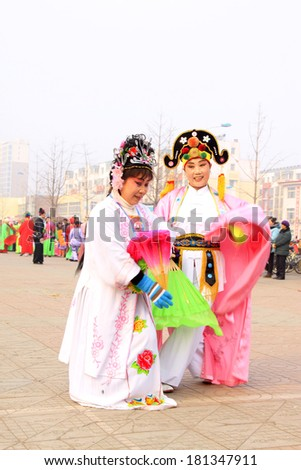 LUANNAN COUNTY - FEBRUARY 15: Performer wearing colorful clothes, performing yangko dance in the street, during the Chinese Lunar New Year, February 15, 2014, Luannan County, Hebei Province, China.