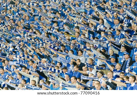 LUBIN, POLAND - APRIL 29: Lech Poznan supporters cheer during a match between Polish Ekstraklasa and KGHM Zaglebie Lubin - Lech Poznan on April 29, 2011 in Lubin, Poland. The score was 1-0.