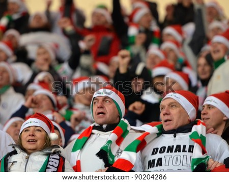 LUBIN, POLAND - DECEMBER 05, Match Polish Ekstraklasa between KGHM Zaglebie Lubin - Legia Warszawa 0:4. Cheering fans dressed up as St. Claus on December 05, 2011 in Lubin, Poland.