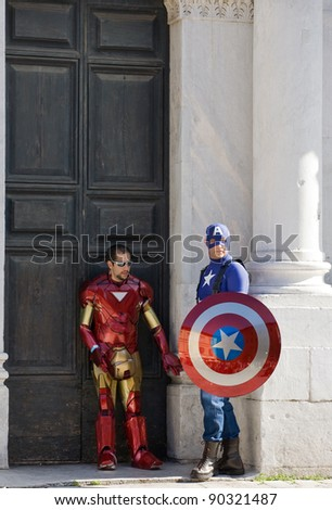 LUCCA, ITALY - OCTOBER 30: Superheroes standing in front of the Cathedral's gate during the Lucca comics and games annual festival on october 30, 2011 in Lucca, Italy.