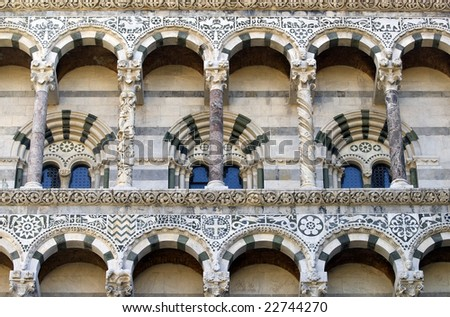 Lucca (Tuscany, Italy) - Detail of the Cathedral facade, with arches and columns