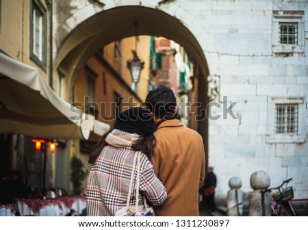 Lucca, Tuscany, Italy: Hugging Interracial Couple From Behind