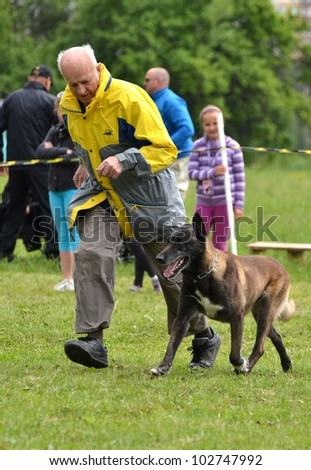 LUCENEC, SLOVAKIA MAY 13, Unidentified man showing training dog in Horse Day May 13, 2012 in Lucenec, Slovakia