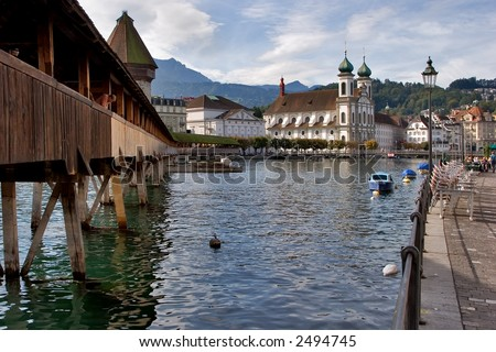 Lucerne lake quay with wooden bridge and a church