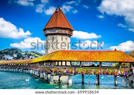 Photo of  Lucerne, Switzerland - Famous wooden Chapel Bridge, oldest wooden covered bridge in Europe. Luzern, Lucerna in Swiss country.