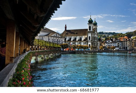 LUCERNE, SWITZERLAND - OCTOBER 2: View from the Chapel Bridge on October 2, 2010 in Lucerne, Switzerland. The oldest wooden covered bridge in Europe.