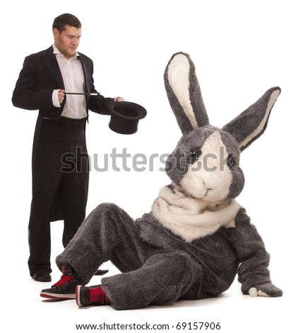 Luckless magician conjuring with a inconceivable rabbit over white background - stock photo
