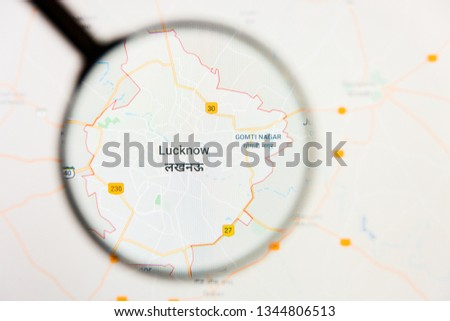 Lucknow, India city visualization illustrative concept on display screen through magnifying glass #1344806513
