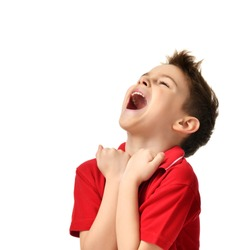 Lucky brunette kid boy happy screaming winning looking up in red t-shirt isolated white background
