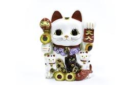 Lucky cat (Maneki Neko) on white background. Common Japanese sculpture bring good luck to the owner.