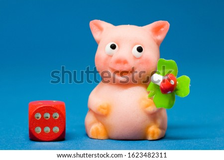 Lucky charm pig of marzipan and dice