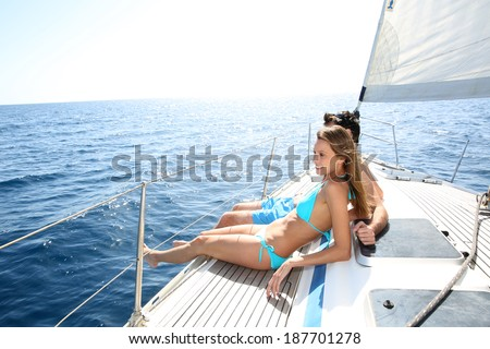Lucky couple relaxing on sailboat deck  #187701278