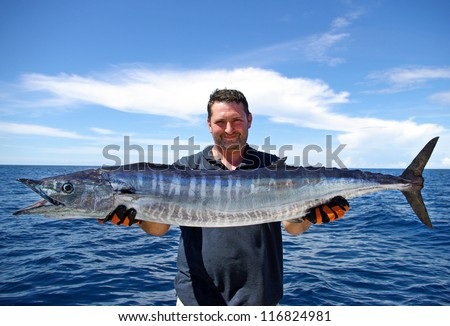 Lucky  fisherman holding a beautiful wahoo fish #116824981