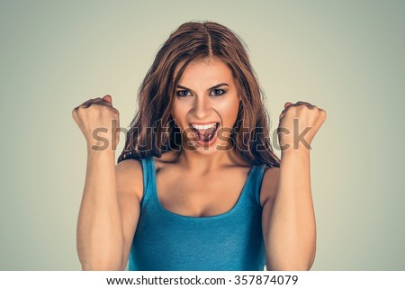 Lucky girl. Closeup portrait happy young woman happy exults pumping fists ecstatic isolated green wall background. Celebrate success concept. Human facial expression emotions feelings body language