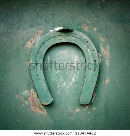 Lucky horseshoe on green metal, Croatia