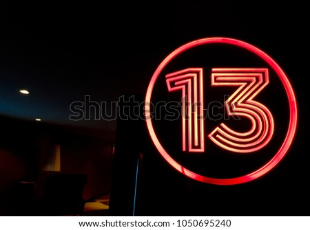 Lucky Number 13 On the red light sign Top of the cinema door