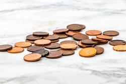 Lucky pennies on a marble top. Calgary, Alberta, Canada