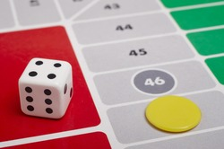 Ludo board game detail with dice and game piece. Horizontal