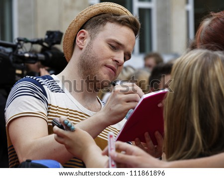 LUDWIGSBURG - AUGUST 29: Musician Olly Murs , many national and international superstars from the music scene in the Forum Theatre celebrated in Ludwigsburg, Germany.  August 29, 2012. - stock photo