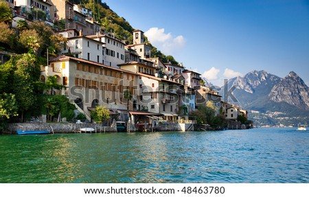 Lugano lake in Switzerland. View on shore with buildings. - stock photo