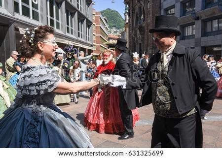 Lugano, Switzerland - April 29, 2017: Venetian masks exhibited  with dances in Lugano on Switzerland #631325699