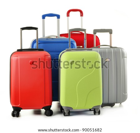 Luggage consisting of five polycarbonate suitcases isolated on white