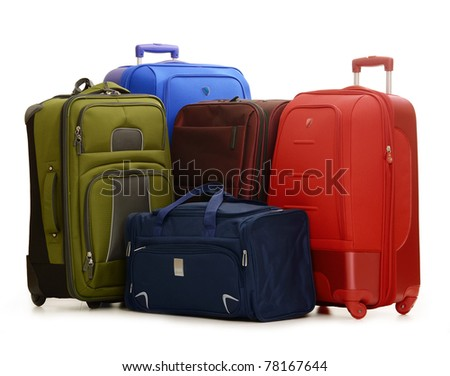 Luggage consisting of four large suitcases and travel bag isolated on white