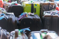 Luggage consisting of large suitcases rucksacks and travel bag.