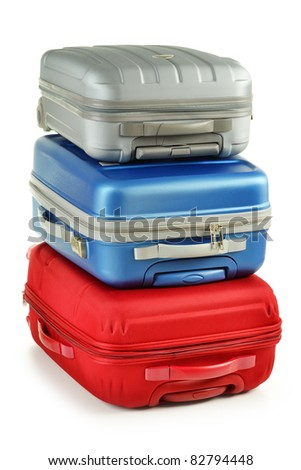 Luggage consisting of polycarbonate suitcases isolated on white. Red blue and grey travel bags