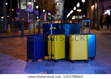 Luggage consisting of six polycarbonate suitcases standing on the street