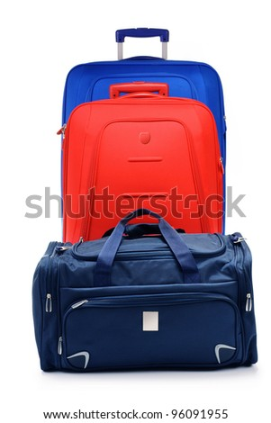 Luggage consisting of two large suitcases and travel bag isolated on white