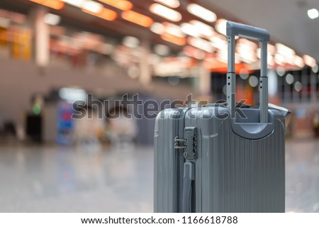 luggage holder on suitcase or bag with TRAVEL INSURANCE ,traveling luggages in an airport terminal,before passenger  and plane flying over sky,Can be used for montage or display your products