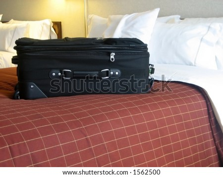 luggage in the beds of a hotel room