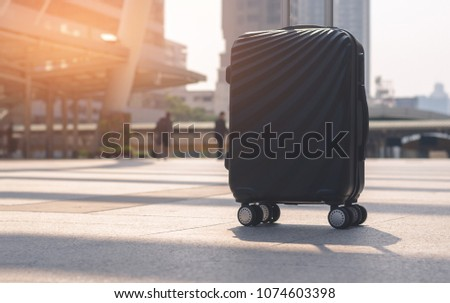 luggage on concrete floor at outdoor in the city with sunlight and go to travel planning in vacation time concept.