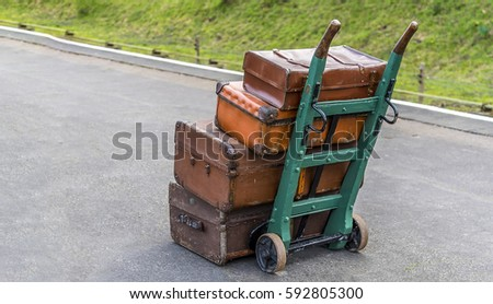 luggage stacked on a trolley on ...
