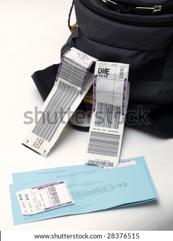 luggage with barcode label on white background