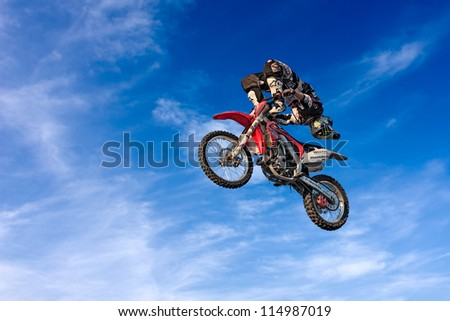 """LUGO, RA, ITALY - OCTOBER 6:  a stunt biker make an acrobatic jump at the motocross freestyle show """"Monster Pirate Troop"""" during the festival """"Rombi di passione"""" on october 6, 2012 in Lugo, RA, Italy"""