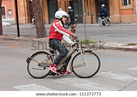 "LUGO, RA, ITALY - SEPTEMBER 30: unidentified  biker riding an old italian moped with engine roller Garelli Mosquito at motorcycle festival ""Rombi di passione"" on september 30, 2012 in Lugo, RA, Italy"