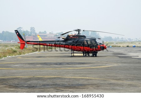 LUKLA AIRPORT,NEPAL - APRIL 14:rescue helicopter preparing to evacuate mountain climbers after accident from Everest Base Camp, Lukla airport, Nepal on April 14, 2013.