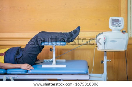 Lumbar traction , Medical Lumbar traction equipment for physiotherapy. treatment physiotherapy. Stockfoto ©