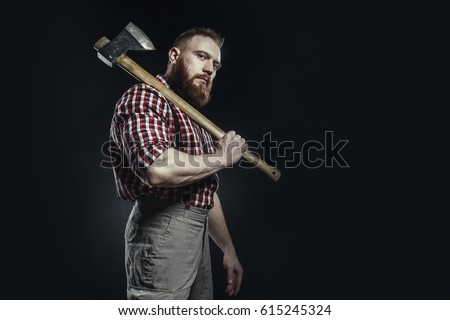 Lumberjack brutal bearded man in red checkered shirt with a smoking tube and ax on dark background  Stock photo ©