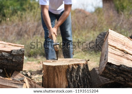 In Winter A Man With An Axe Chopping Wood Axe Chops Firewood Images