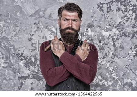 Lumbersexual concept. Facial hair care. Retro barber. Barber equipment. Barber salon. Man bearded hipster with long beard and mustache. Well groomed hipster. Barbershop concept. Beauty industry.
