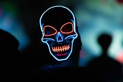 Luminating Light-up skull mask shot at a local night event