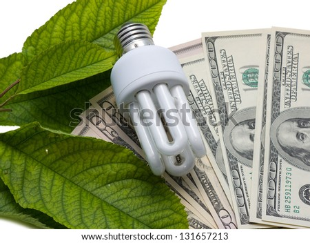 Luminescent lamps on a background from dollars