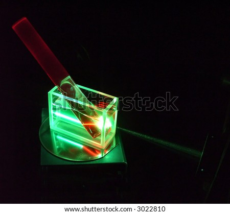 luminescent ruby rod under a beam of green laser