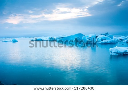 Luminous blue icebergs floating in Jokulsarlon glacial lagoon, Iceland